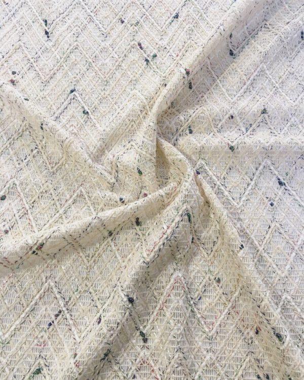 Костюмная ткань типа Chanel в ромбы с цветными узелками (молочно-белая)