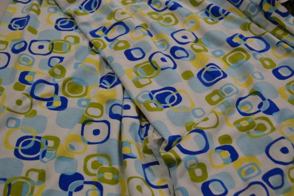 Трикотаж белый квадраты (желтого и синего цвета)